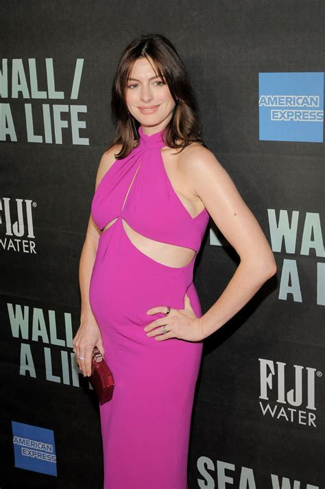Anne Hathaway Shows Off French Girl Hair—And a Growing