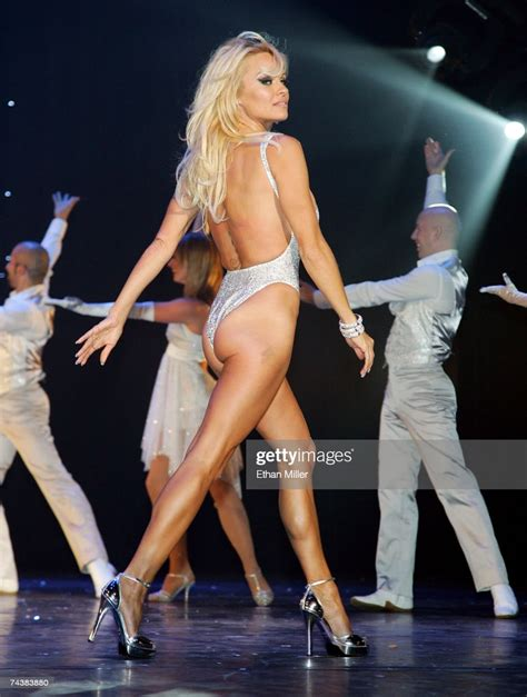 Actress Pamela Anderson walks across the stage during the