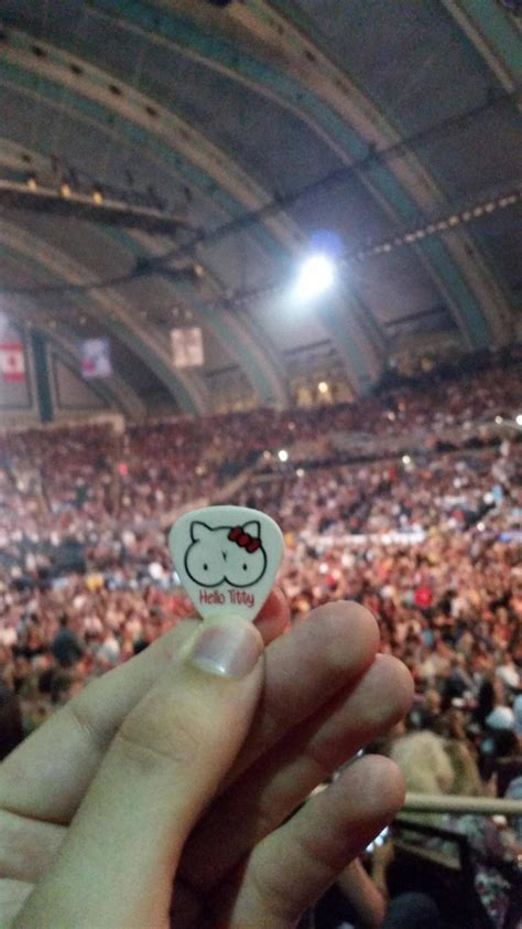 A Fan Shows Off a Hello Titty Guitar Pick From Slash