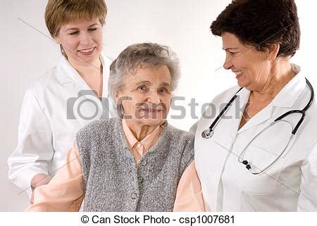 Stock Photography of Health care workers and elderly woman
