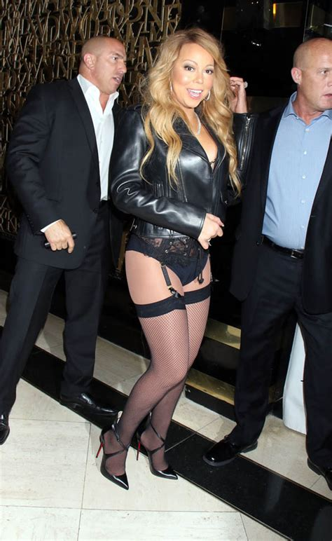 Mariah Carey in a leather jacket and no pants at 1-Oak in